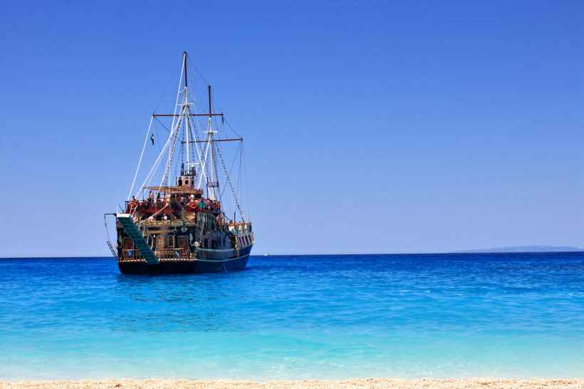 A pirate ship, seen from the beach.
