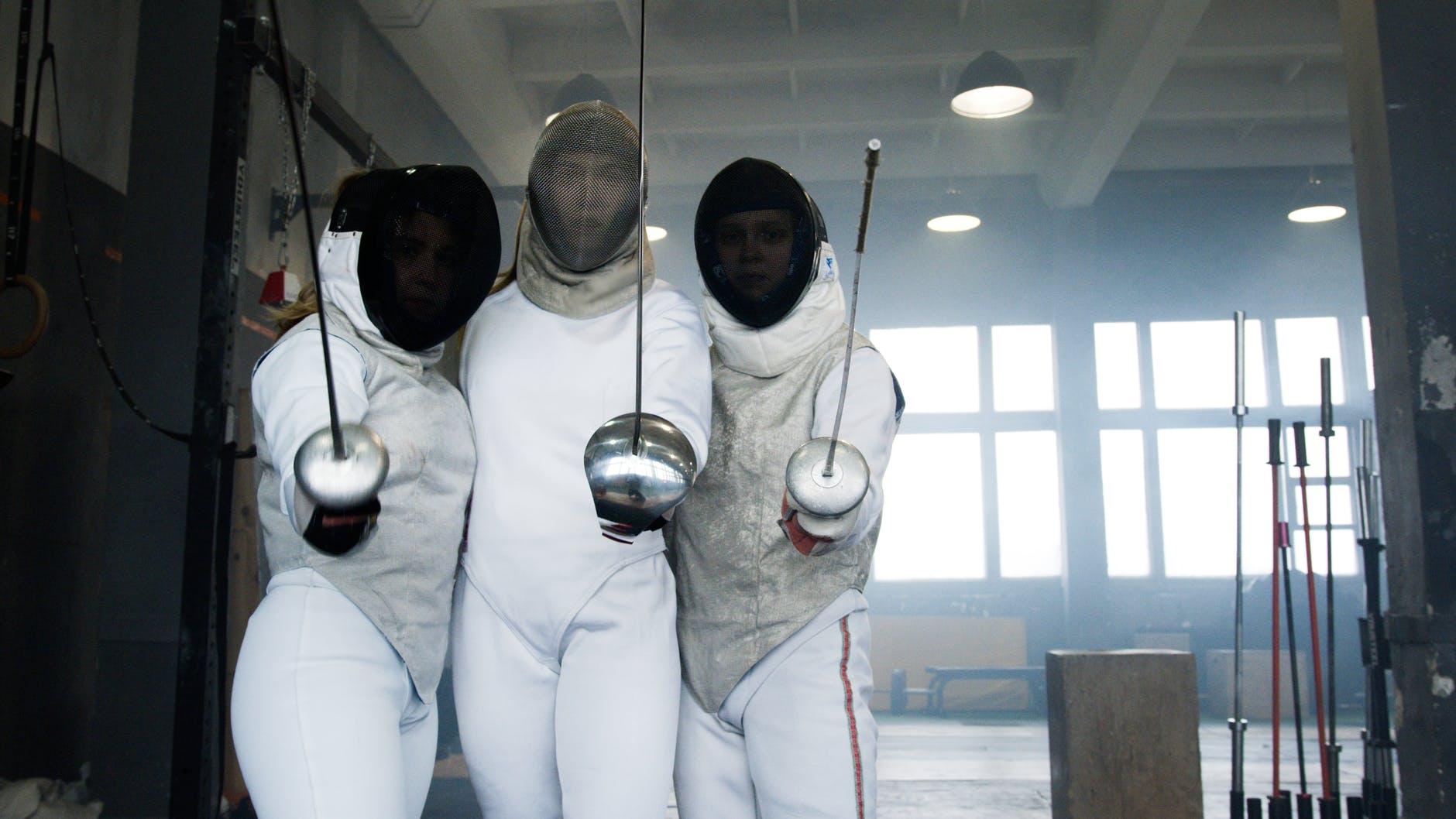 Three modern fencers.
