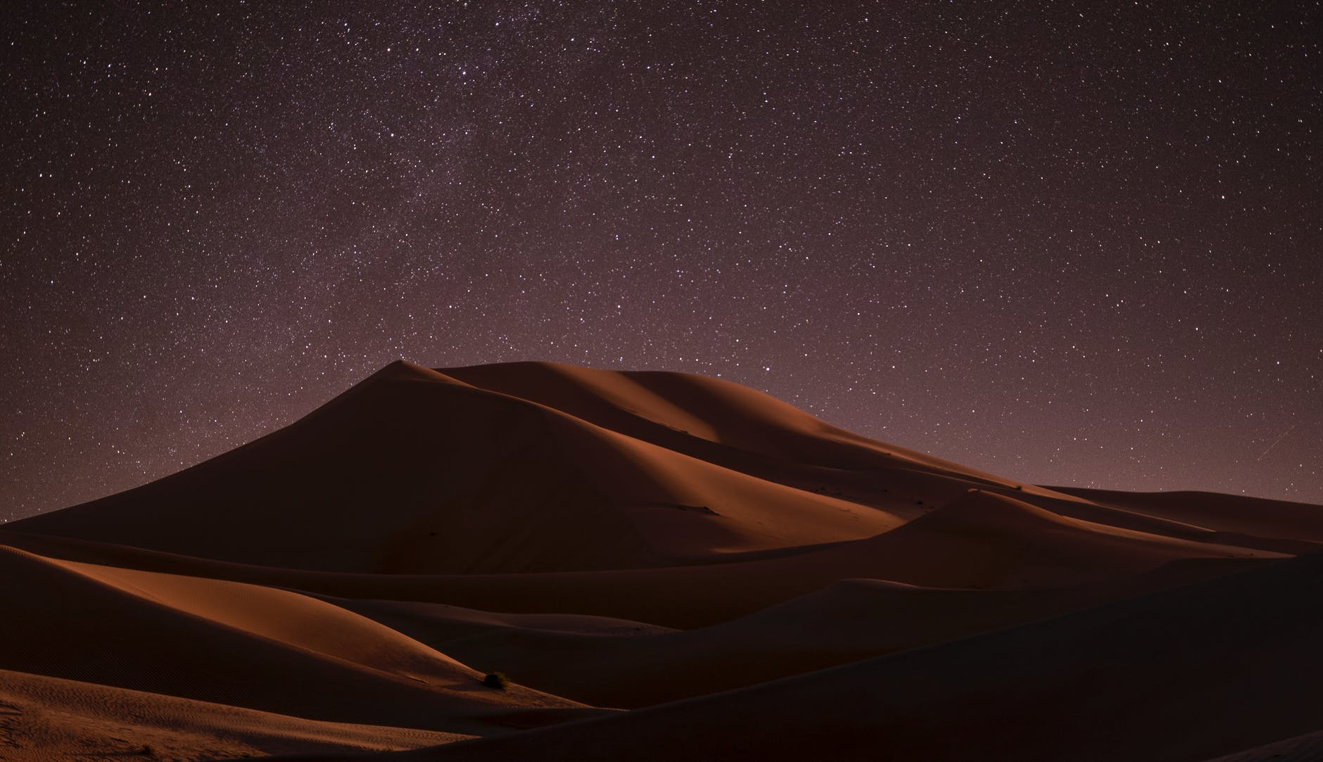 A sand dune at night.