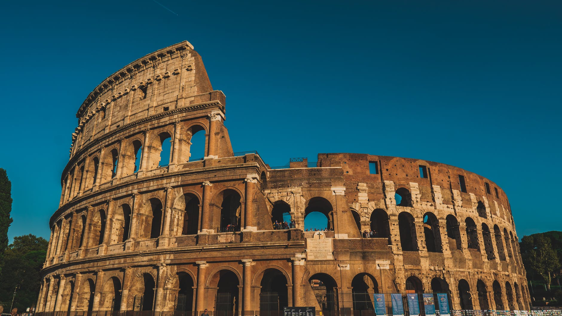 The Colosseum at dusk. Photo by Chait Goli on Pexels.com