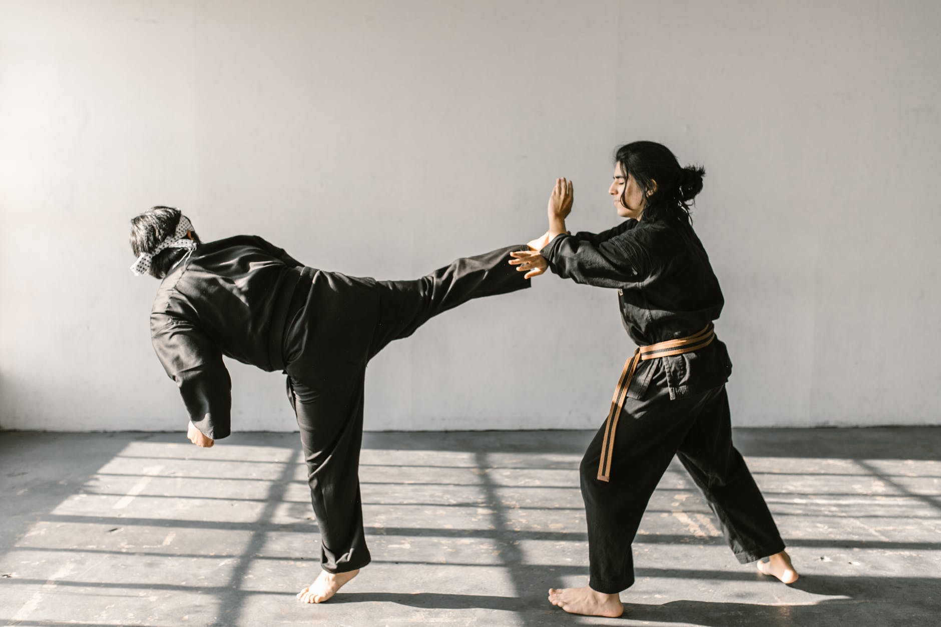 Two people sparring in an unspecified martial art.