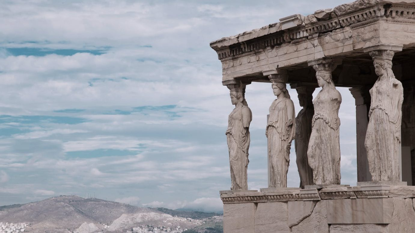 The corner of the caryatid porch of the Erechtheion on the Acropolis of Athens. Photo by jimmy teoh on Pexels.com
