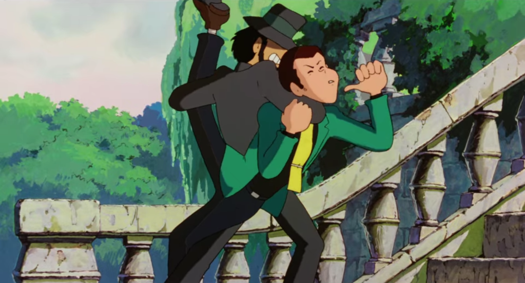 """Jigen grabbing Lupin in an elaborate submission hold in a scene from """"The Castle of Cagliostro""""."""