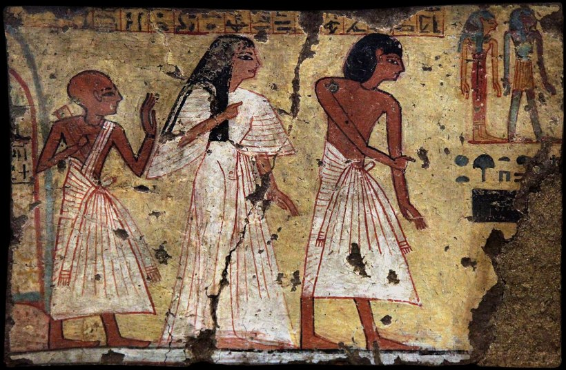 An Ancient Egyptian wall painting depicting a man, woman, and priest.