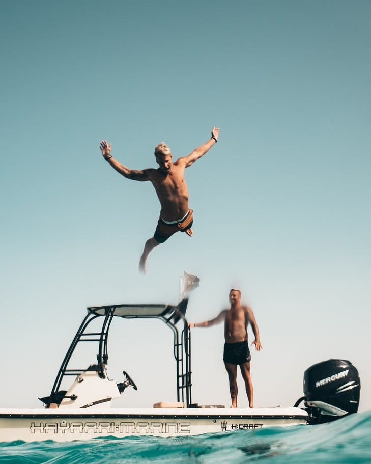 A man about to belly-flop in the water.