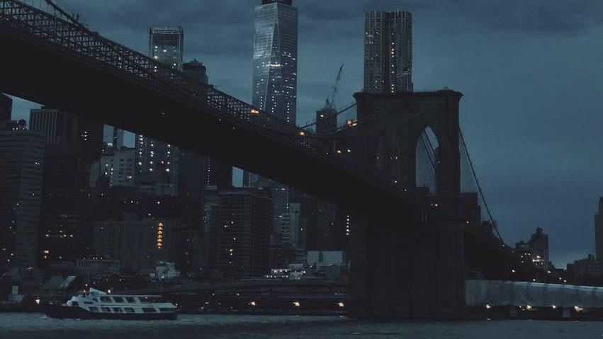 The Brooklyn Bridge on a cloudy night.