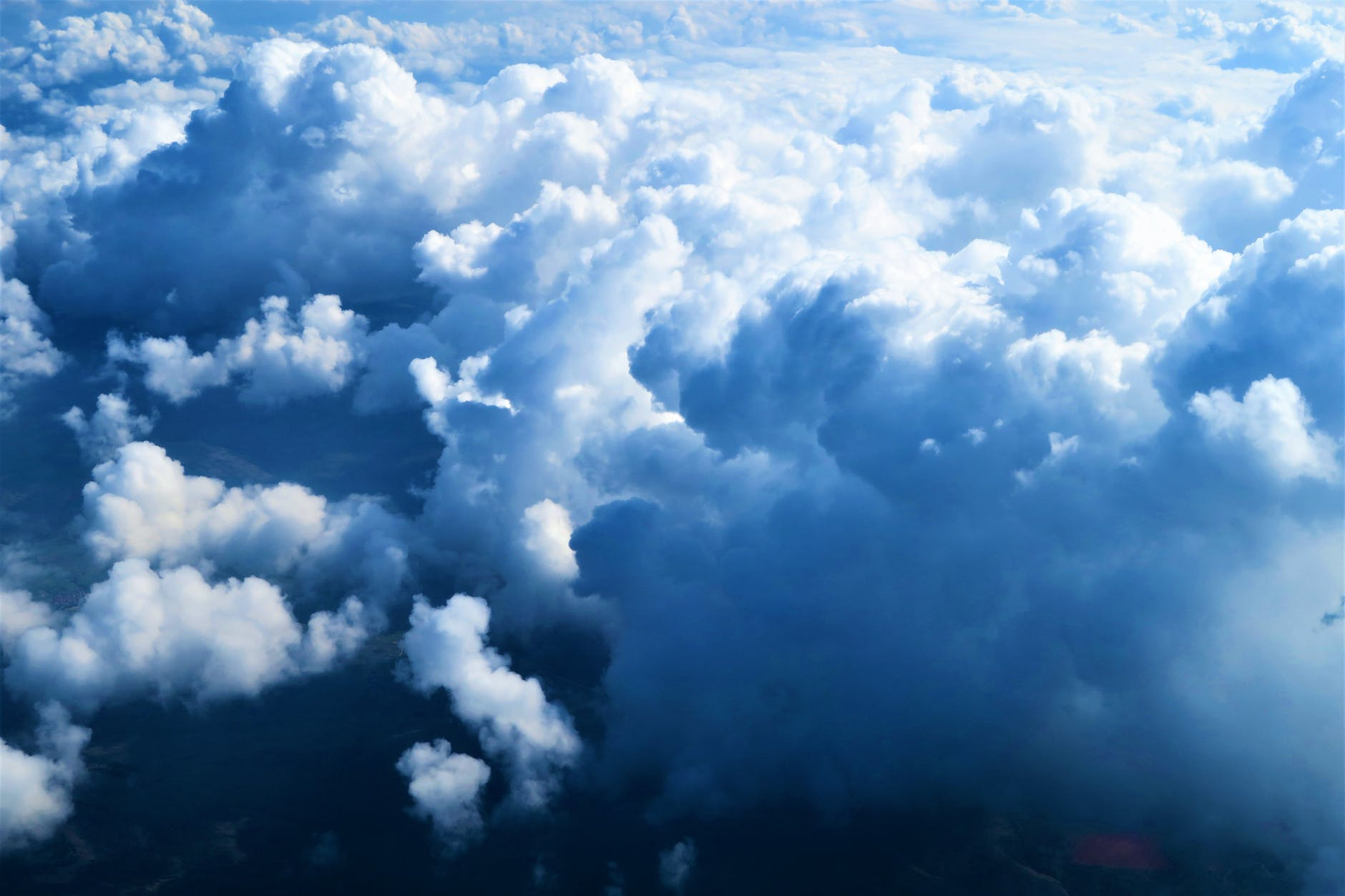 A sky full of clouds, seen from above the clouds.