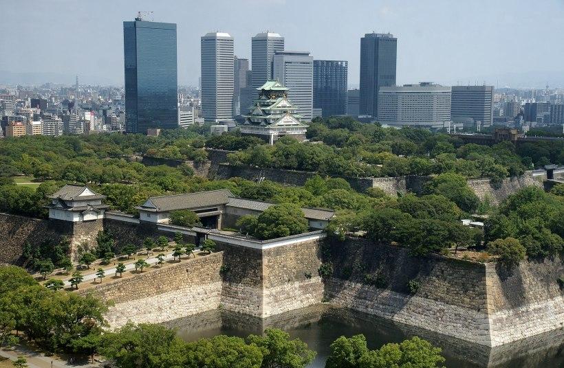 The skyline of Osaka, prominently featuring Osaka castle.
