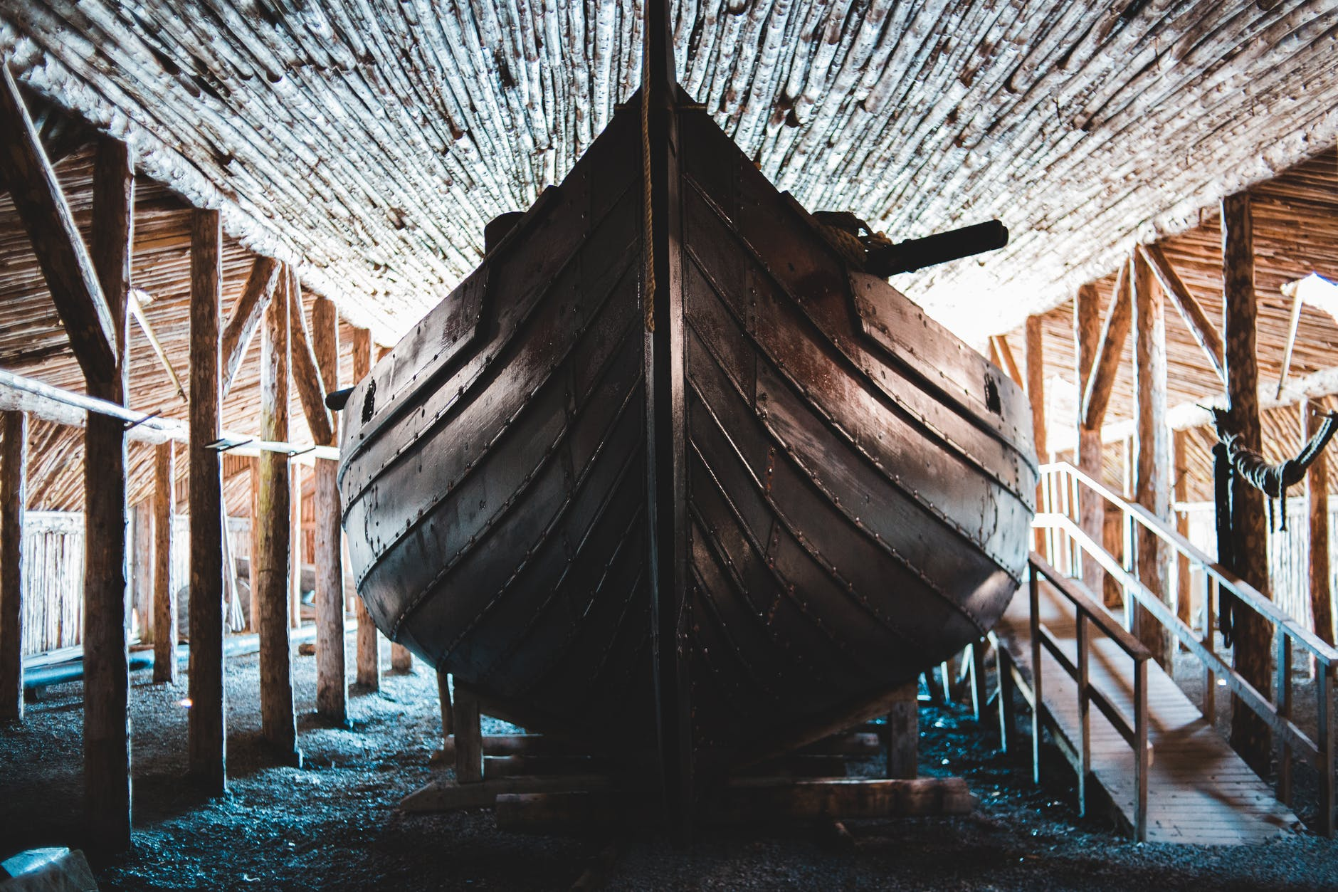 A Viking longship in a boathouse.