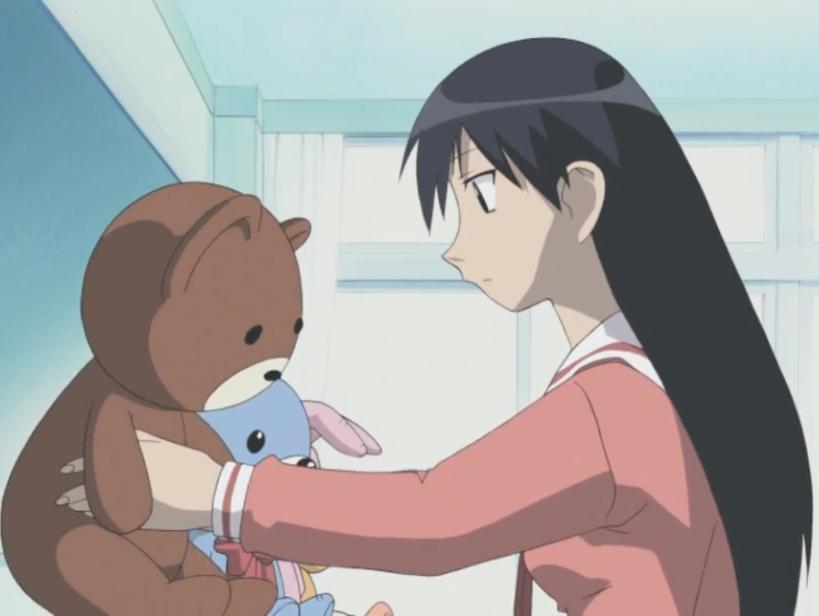 A scene from Azumanga Daioh: Sakaki preparing a display of stuffed animals.