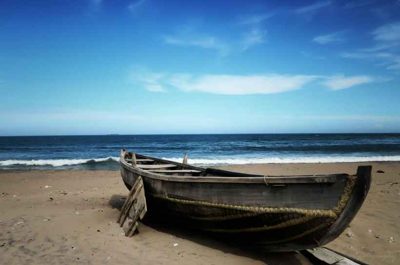 A boat on the beach.