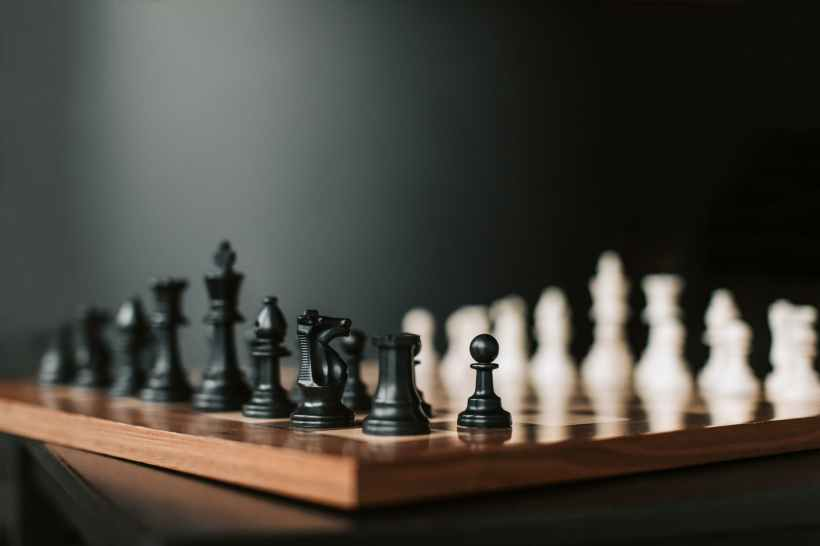 A chessboard laid out for the start of a game.